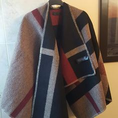 ICONIC CAPE! Burberry prorsum mega check cape The hottest item this year. Gorgeous Burberry like Prorsum Mega Check cape. Brand new. Material and labels exactly like the original except for the price. Super warm. Used my own as an airport must. Burberry Jackets & Coats Capes