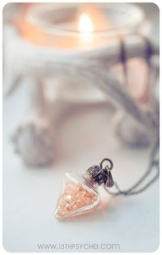 A beautiful handmade Glass diamond shape pendulum. This elegant diamond shaped glass vial is filled with tiny salmon-orange colour rhinestones. Its also decorated with a bronze holder and cap , creating a delicate and beautiful pendant.  Size: - Bottle pendant Size : 30X24 mm - Necklace lenght: around 60 cm (26 inch aprox.)  All the products are shipped well packaged, in a custom box with an cute organza bag :)  All the bronze parts are nickel free and non toxic ;)  ✦ Some colors may vary a…