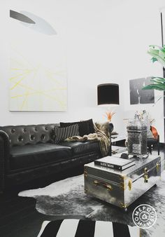 This painting from Uprise Art would probably cost $5000 on its own but Uprises's budget-friendly service lets clients own great, large scale items. The sofa is typically a splurge item but with a discount from Swatch, Noa saved on this lovely tufted leather Chesterfield https://www.homepolish.com/mag/5k-living-room?utm_source=pinterest&utm_medium=profile&utm_campaign=noas_apt