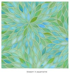 Pretty in a small area, or an accent feature (like a strip up the wall). Ann Sacks Blossom in Aquamarine glass tile