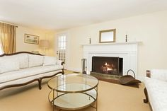 Built in 1900, this pristine Colonial features all the charm of yesteryear with today's updates and conveniences.  This cozy living room features a beautiful fireplace with a gorgeous detailed mantle.  Located at our listing at 44 Pound Hollow Court in Old Brookville.  Listed by Carolina Boucos. #fireplace #luxurylisting #danielgale #DGSIR #longislandsgoldcoast