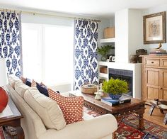 decorology - I big puffy hearts love this room - the warm woods, traditional rug, bold curtains
