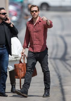 Ryan Gosling, 35, looked smokin' hot in casual denim, a red buttondown and sunnies. His signature manicured coif and a retro-looking leather duffle completed his spot-on ensemble. (Photo by RB/Bauer-Griffin/GC Images)  via @AOL_Lifestyle Read more: http://www.aol.com/article/2016/05/10/sexy-stars-kate-moss-gigi-hadid-stun-in-hot-styles/21374731/?a_dgi=aolshare_pinterest#fullscreen