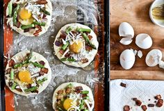 Bacon, Egg + Asparagus Personal Pizzas.... Minus the asparagus.. Great for breakfast!
