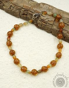 http://earthwhorls.com/collections/necklaces/products/1509sn  Handmade glass & agate necklace - spring and summer perfection!  20% off for Mother's Day - code LOVEMOM - free shipping!