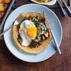 These gorgeous, oozy crepes will please vegetarians and carnivores alike 400g spinach Knob of butter 400g chestnut mushrooms, roughly chopped  175g stilton, crumbled 2 tbsp vegetable oil, plus extra for heating pancakes 4 large free-range eggs 4 ready-made crepes (see tip)