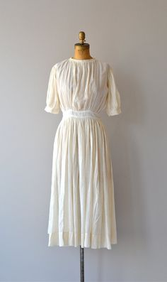 Antique 1910s cream cotton gauze dress, very simple with high gathered neckline, short cuffed sleeves, banded waist with back hook and eye closures