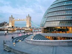 A new landmark (city hall;right) meets old (Tower Bridge;left) along Thames River