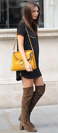Emily Ratajkowski in a cute fall outfit: black dress, yellow bag, brown suede boots