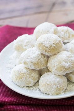 These Butter Snowballs Cookies are soft, buttery, melt in your mouth cookies! They are a favorite holiday cookie made with butter, nuts and powdered sugar.