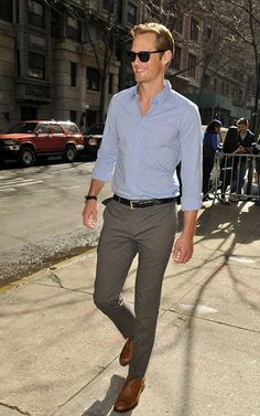 soft blue oxford. gray slacks. black belt/watch. brown shoes. shades. real. comfortable. Friday style.