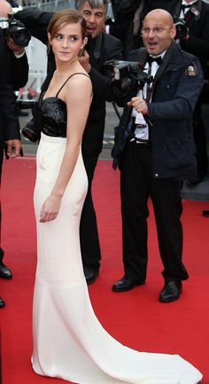 Emma Watson at the 2013 Cannes Film Festival wearing a long off-white silk crepon dress with black embroidered sequins from the Spring/Summer 2013 Haute-Couture Collection