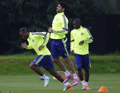 Didier Drogba (left) back in training with team-mates Diego Costa (centre) and Ramires (right)