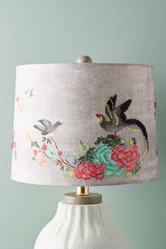 "Gardenbird Lamp Shade | Birds perch along vibrant petals on this cheerful shade.  Hardbacked polyester silk with brass-plated iron frame Embroidered detail Slightly tapered silhouette | S: 8""H, 10"" dia 