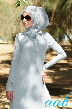 """Sheath Dress"" style abaya with coordinating hijab scarf... the glam glasses are an added touch!"