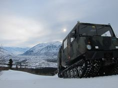 Sgt. Champlin, a medic and instructor at the U.S. Army Northern Warfare Training Center, operates a Small Unit Support Vehicle (SUSV) in the mountains above the Black Rapids Training Site during a demonstration of the vehicle's capabilities to Cold Weather Orientation Course students. Photo taken by Capt. Richard Packer, US Army Alaska Public Affairs.