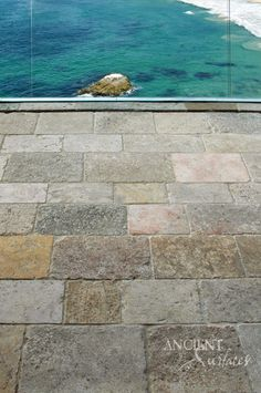 Antique Reclaimed Biblical Stone in an Ocean Front Home in California provided by Ancient Surfaces. http://www.ancientsurfaces.com