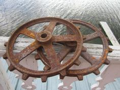 pr. iron gears, wheels, cogs, farm find, industrial,,repurpose me....don't cha just love rusty gears?