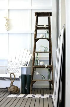 And I just happen to have an old rickety ladder… I think I prefer the wall mounted version though. (from www.shelterness.com)