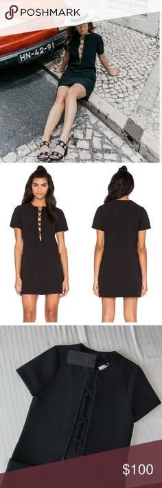 Kendall + Kylie Black Lace Up Dress •A retro-inspired KENDALL + KYLIE shift dress with a lace-up split neckline. Patch front pockets. Short sleeves. Unlined. Fabric: Bonded crepe. 95% polyester/5% spandex.  •Size XS, true to size and best for a 0-2.  •New with tag.  •NO TRADES/HOLDS/PAYPAL/MERC/VINTED/NONSENSE. Kendall & Kylie Dresses Mini