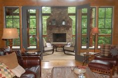 the 4 season room with the stone fireplace.....my dream!