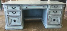 "This executive desk is simply stunning. The details on it are accentuated with the distressing and the faux paint style makes it pop. What do you think?  The dimensions are 72"" L, 36"" W, 31"" H. SOLD!! For $525.  https://www.pinterest.com/shabbychictexas/my-shabby-chic-desks/"