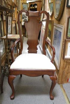 "VILLAGE ANTIQUE CENTER AT HYDE PARK HYDE PARK, 845-229-6600  ""We have a lovely copy of a Queen Anne chair from the 50s. In fact, we have a whole set of eight—six sides and two ends—which look great around any table. The style is my favorite— traditional but very elegant."""