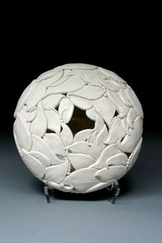 Leaf Harmony - Whiteearthstudio. Round ceramic sculpture constructed with leaf shaped pieces.