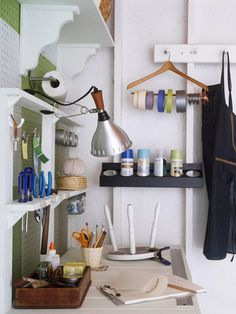 "Love that spray paint holder!  ""Everything in Its Place - Simple modifications helped transform a potting bench into a tool bench. Large holes routed into a shelf now offer storage for everyday tools. A metal ruler screwed to the bench top is always ready for a quick measurement. Jars, hooks, and magnetic clips provide easy access to notes, nails, and keys."