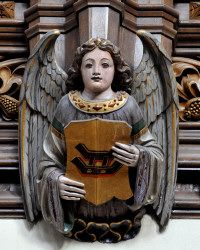 From Allerton Castle, an angel holding a shield with a sledge, which is the badge of the Stourton family.