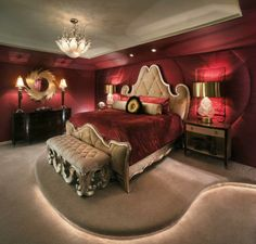 Charles Neal Interiors - The rich colors of burgandy and gold caught our eye with this room. Add to it the recessed ceilings and lighted platform as well as the tufted walls and we love this room!
