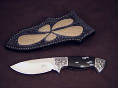 """""""Chama"""" obverse side view in 440C high chromium stainless steel blade, hand-engraved low carbon steel bolsters, snowflake obsidian gemstone handle, emu skin inlaid in hand-carved leather sheath"""