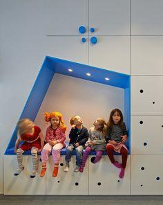Sjötorget Kindergarten in Stockholm by Rotstein Arkitekter | inverted volumes create sitting spaces + storage walls