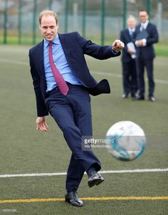 Prince William, Duke of Cambridge takes a penalty kick as he visits the Football…