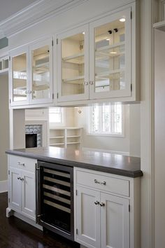 Cameo Homes: Custom pass through wall dividing living room and kitchen. Overhead cabinets with glass ...