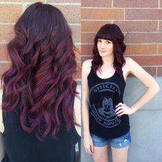 Plum hair. Red hair. Soft curls. Straight across bangs.