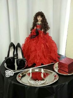 Last doll, crown, scepter, shoes, and gift.