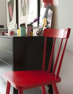 Consider extending a bold colour scheme to furniture and art for a room that really packs a punch