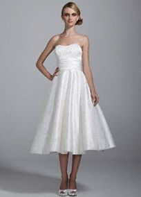 You'll be Pretty in Pink in this delicate and exquisite satin wedding dress!  Strapless satin wedding dress features all over ultra-feminine pink floral print.  Ruched empire waist detail helps create a stunning silhouette.  Short skirt gives this dress a young fresh feel and features pockets.  Fully lined. Back zip. Imported polyester. Dry clean.  To preserve your wedding dreams, try our Wedding Gown Preservation Kit.