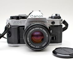 Canon AE-1 Program 35mm Film SLR Camera with Canon FD f1.8 50mm Lens by BigBoyVintage on Etsy