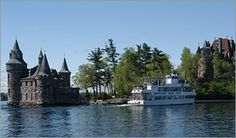 """A visit to the grandest of all the Gilded Age Mansions, Boldt Castle offers a glimpse into one of the most compelling love stories in history. An eternal monument to the memory of a man's love for his wife. In 1904 construction was well underway on the 120 room castle when tragedy struck. A telegram announcing the death of George C. Boldt's wife arrived...three hundred artisans and craftsmen were commanded to """"stop all construction."""" A broken hearted Boldt never returned to the island…"""