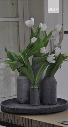 How lovely these tulips look in homemade concrete vases.  Why not give it a try!