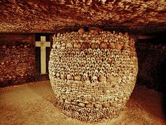 Catacombs of Paris. Behind the assembled piles of skulls, tibias, and femurs in the Paris catacombs is a chaos of bones. In the 18th and 19th centuries the city dug up an incredible number of skeletons from over-flowing cemeteries and added them at night into old quarries.