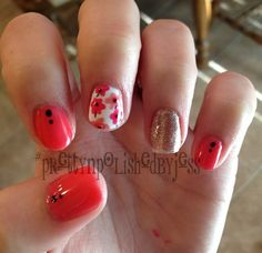 Coral pink and gold flower shellac nails