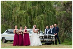Bridal Party infront of the vintage GT Limo and lush weeping willow trees at Redcliffe on the Murray in Pinjarra.  Photography by Trish Woodford Photography