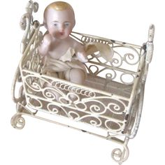 Tiny All Bisque Antique Baby Doll in Vintage Metal Cradle