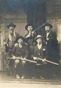 """Fort Smith (Sebastian County) posse, under the jurisdiction of Judge Isaac C. Parker, sent out to arrest Ned Christie, a Cherokee man alleged to have killed a deputy marshal. The picture was taken in Vinita, Indian Territory, on November 2, 1892. (Clockwise from left, back row): Bill Smith, Bill Ellis, Paden Tolbert, Gideon S. """"Cap"""" White, and Charles Copeland."""