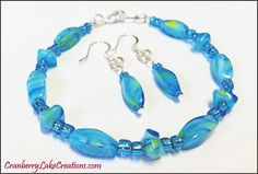LOVE this Mixed Aqua Glass Bead Earrings and Bracelet Set by Cranberry Lake Creations!