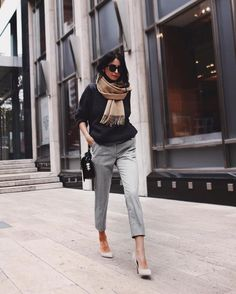 light grey cropped pants, a black sweater, heels and a scarf
