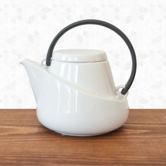 Ridge Teapot. This teapot is not only beautiful, it's also ergonomic. It is designed so that the handle can be held at an angle to reduce wrist stress and aid in easy pouring. A notch in the lid prevents it from falling off when pot is tipped.  It comes with a removable, stainless steel strainer. Microwave and dishwasher safe. Holds approximately 25 oz. By Kinto, $64.